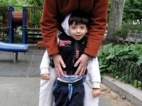 Samuel Habib, 3, walks with his mother, Betsy McNamara, during a trip to NYC.    Dan Habib photo