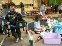 Samuel Habib, 3, uses his walker to make his way through his class at Shaker Road School in Concord, NH.    Dan Habib photo