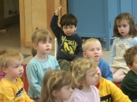Samuel Habib, 3, sits in his supportive corner chair and raises his hand during circle time.    Dan Habib photo