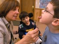 Samuel Habib, 3, has a speech therapy session with therapist Barbara Jobin, left, and classmate Zachary Faretra.    Dan Habib photo