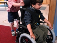 Samuel Habib, 3, uses his wheelchair with friend Jason Bogacz, 4 at Shaker Road School.    Dan Habib photo