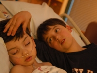 Samuel, comforted by his brother, Isaiah, was back in the hospital after pneumonia and other complications from a tonsilectomy at Dartmouth Hitchcock Medical Center in Lebanon, NH.  Dan Habib photo