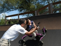 "Samuel and his father, Dan Habib, ride the half-pipe of a skate park in Hopkinton, NH, with the help of Samuel's ""Bronco"" walker.  Dan Habib photo"