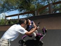 "Samuel and his father, Dan Habib, ride the half-pipe of a skate park in Hopkinton, NH, with the help of Samuel's ""Bronco"" walker.  Dan Habib photo"