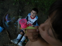 Samuel and Isaiah play with bubbles near a local pond.  Dan Habib photo