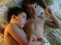 Samuel and Isaiah lie together after a bath.  Dan Habib photo