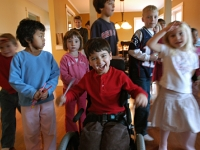 Samuel celebrates his 5th birthday with friends during a treature hunt.  Dan Habib photo