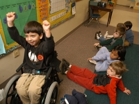 Samuel celebrates getting an answer right at school at Shaker Road School pre-kindergarten.  Dan Habib photo