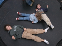 Samuel plays on a trampoline with his brother Isaiah and cousin Natalie Kogan Habib.   Dan Habib photo