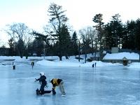 Samuel skates on his Bronco walker at White Park pond with Isaiah.  Dan Habib photo