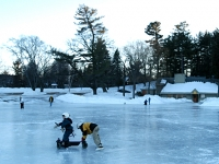 Samuel skates on his Bronco walker at White Park pond with Isaiah.  Dan Habib photo