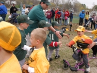 Samuel shakes hands with the other team after his first ever t-ball game at Frisbee Field in Concord.  (Dan Habib/Concord Monitor)