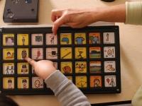 "Samuel works with speech therapist Barbara Jobin on his ""Tech-Talk"" machine at Shaker Road School.  Dan Habib photo"