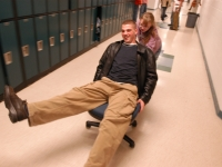 Alana Malfy pushes a student on a chair down the hallway. Dan Habib photo