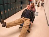 Alana Malfy pushes a student on a chair down the hallway. Dan Habib photo