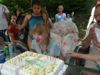 Alana Malfy blows out the candles on her birthday cake. Dan Habib photo