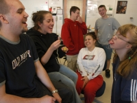 At times, there is a fine line between classmates laughing with or at Alana.  As a class winds down, students blow bubbles and Alana tries to catch them on her tongue, as classmates look on and laugh.   Dan Habib photo