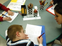 Inclusion facilitators, student teachers and specialists support the classroom teachers at Haggerty so that all students can access the general education curriculum. Classroom para-professional Allison DiDomenico works with Nathaniel during a writing exercise.   Dan Habib photo
