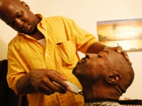 Keith Jones gets a shave from a friend as he gets ready for his wedding day. Jones has cerebral palsy.   Dan Habib photo