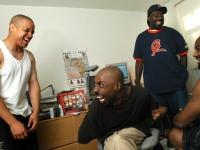 On the morning of his wedding, Keith Jones laughs with groomsmen in his Somerville, Massachusetts, apartment.   Dan Habib photo