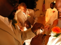 Keith Jones, center, is surrounded by groomsmen just before the wedding ceremony. Jones married Kerlyne Pacombe at the Milton Hoosic Club in Milton, Massachusetts.