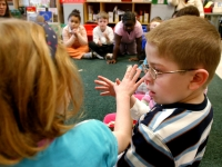 Nathaniel Orellana, a first-grader at the Haggerty School in Cambridge, Massachusetts, participates in an exercise during circle time. Nathaniel, who has a diagnosis of autism, is fully included at Haggerty.