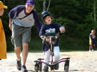 """Dan Habib supports his son, Samuel Habib, during a t-ball game in Concord, NH, on May 27, 2006. Samuel uses a """"Bronco"""" all-terrain walker to hit and get around the bases. From Habib's documentary film, Including Samuel, www.includingsamuel.com.  MANDATORY CREDIT: Lori Duff/Concord Monitor"""